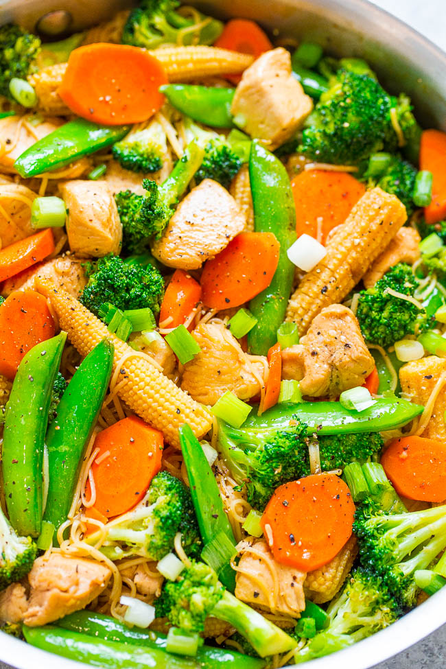 Chicken Stir Fry with Noodles - Skip takeout and make this EASY stir fry that's ready in 15 minutes!! Loaded with juicy chicken, crisp-tender veggies, comforting noodles, and Asian-inspired flavors! Perfect for busy weeknights!!