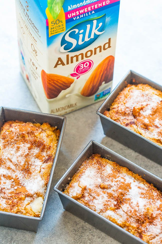 three loaves of cinnamon sugar pumpkin quick bread with carton of Silk almond milk