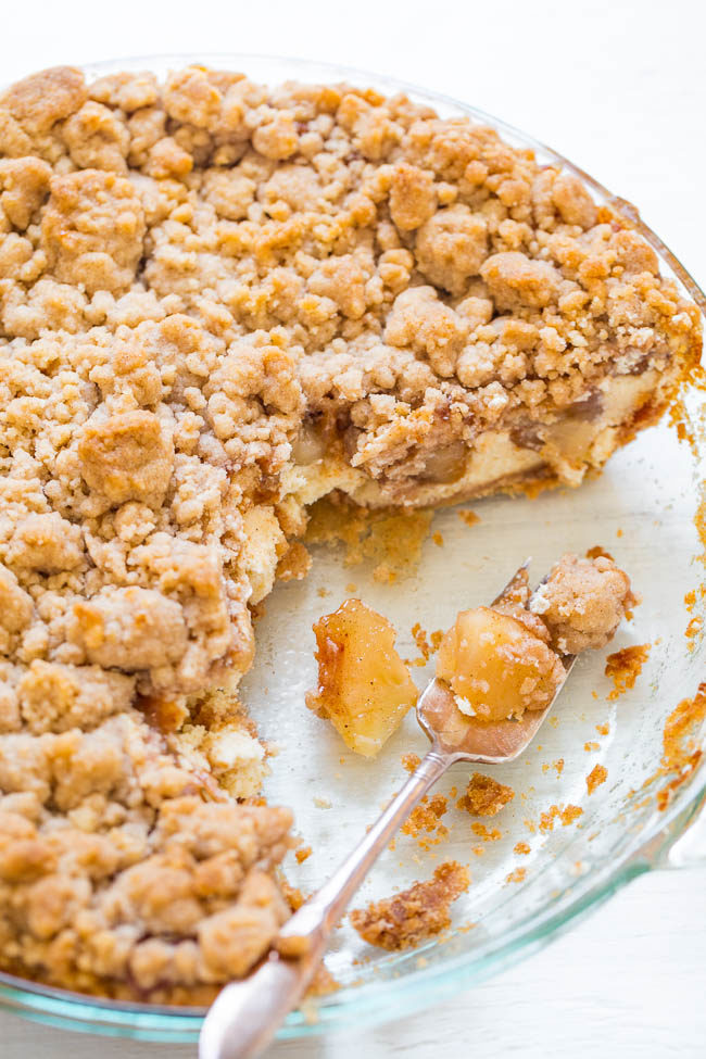 Sugar Cookie Apple Crumble Cheesecake Pie with slices taken out