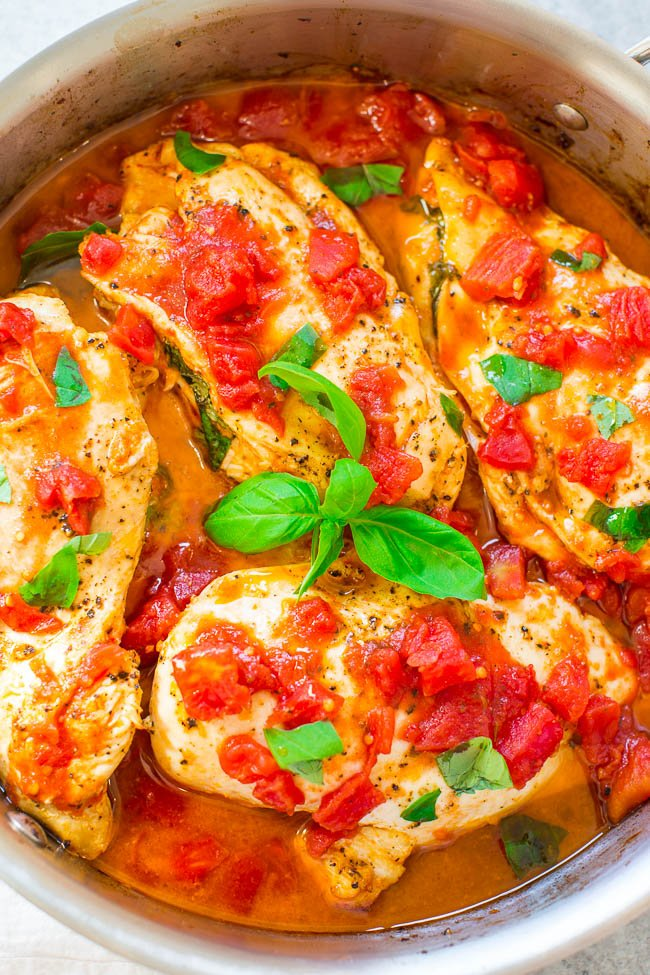 Caprese Stuffed Chicken - Juicy chicken stuffed with sundried tomato pesto, gooey mozzarella cheese, and topped with fresh basil!! EASY, ready in 30 minutes, loaded with FLAVOR, and a family dinner favorite!!