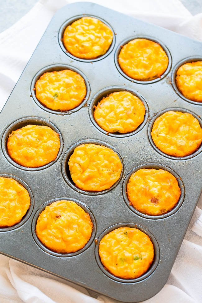 100-Calorie Cheesy Sausage and Egg Muffins - Low carb baked egg muffins that are loaded with juicy sausage and cheese! EASY, ready in 30 minutes, and perfect for breakfast, brunches, snacks, or breakfast-for-dinner! You'll want to keep a stash on hand!!
