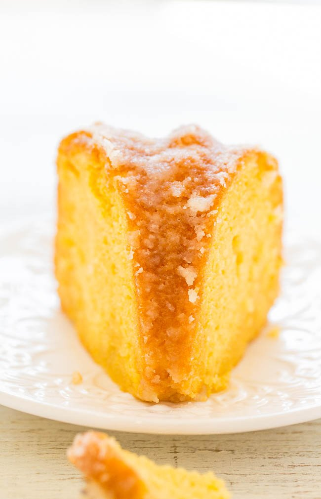 front view of a slice of rum soaked cake on a white plate