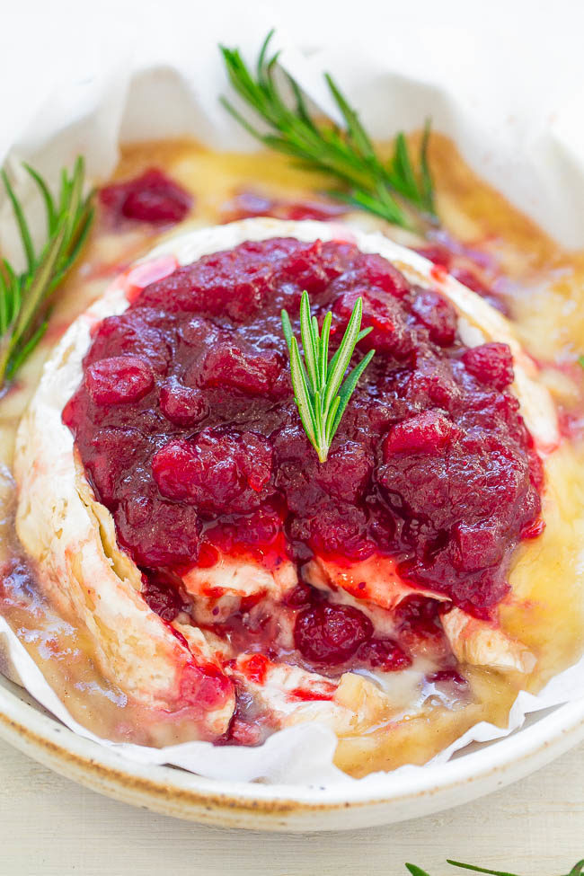 Cranberry Baked Brie — An EASY 15-minute appetizer that's filled AND topped with richly spiced orange-scented cranberry sauce
