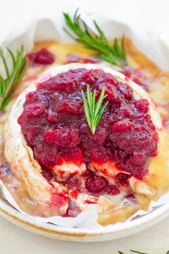 Cranberry brie with rosemary on a white plate