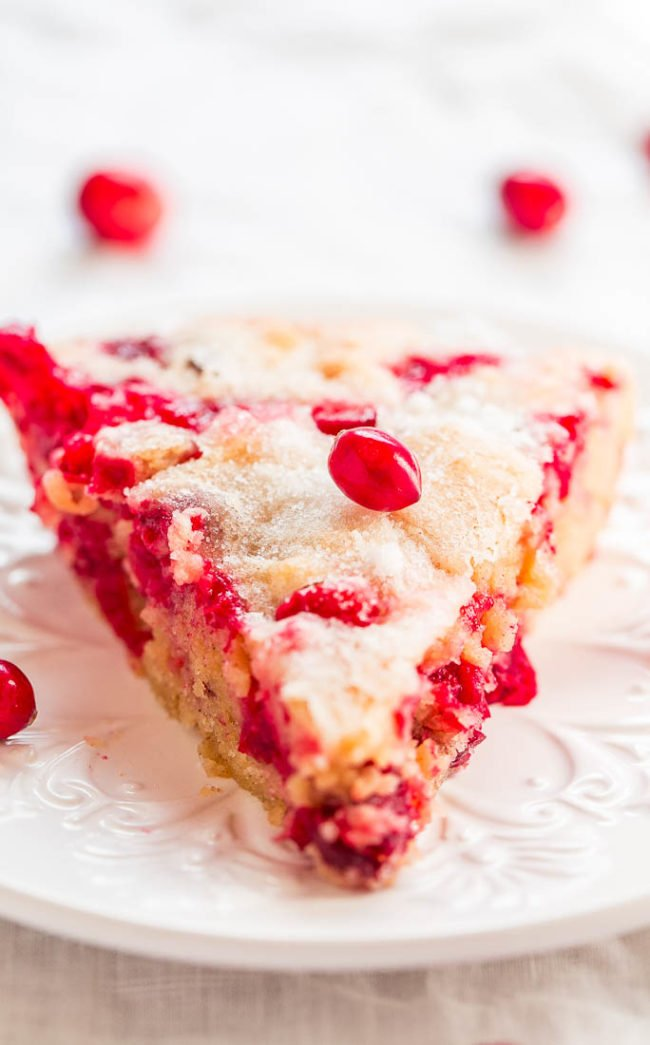A slice of Crustless Cranberry Pieon a white plate