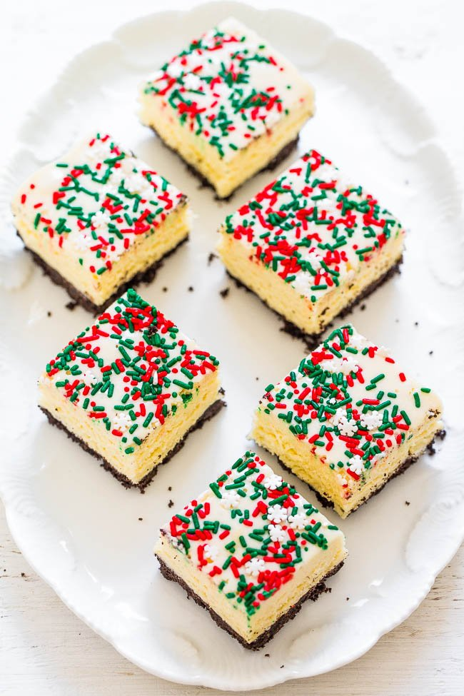White Chocolate Holiday Fudge - This EASY foolproof fudge recipe is perfect for Christmas and holiday parties!! A double dose of white chocolate with an Oreo Cookie crust for the WIN!!