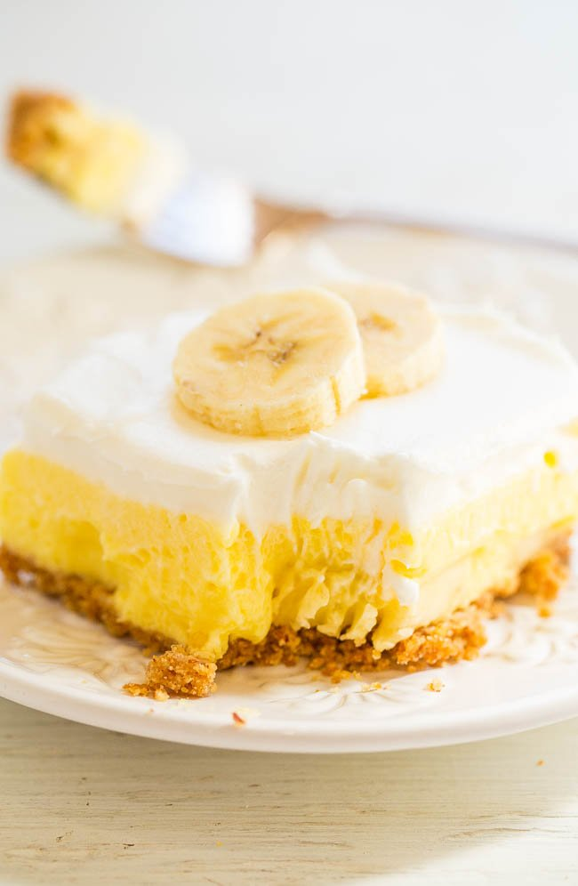 Banana Cream Pie Bars - Faster and easier than making a banana cream pie and taste AMAZING!! A crunchy crust, tender banana slices, luscious banana pudding, and creamy whipped topping make these layered pie bars WINNERS!!