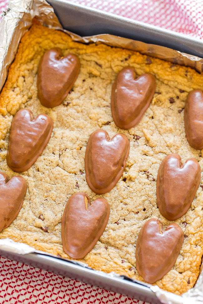 Peanut Butter Chocolate Chip Valentine's Blondies - Fast, EASY blondies loaded with peanut butter, chocolate chips, and topped with peanut butter HEARTS!! Bring them to a Valentine's Day party or surprise someone special!!