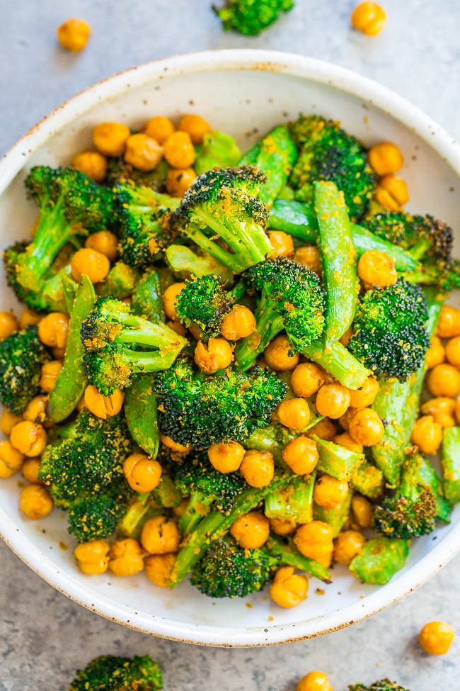 Cheesy Roasted Chickpeas and Broccoli - Fast, EASY, healthy, and keeps you full and satisfied!! Vegan and gluten-free doesn't have to be boring! Perfect lunch, hearty side, or meatless main! You're going to LOVE the cheesy touch!!