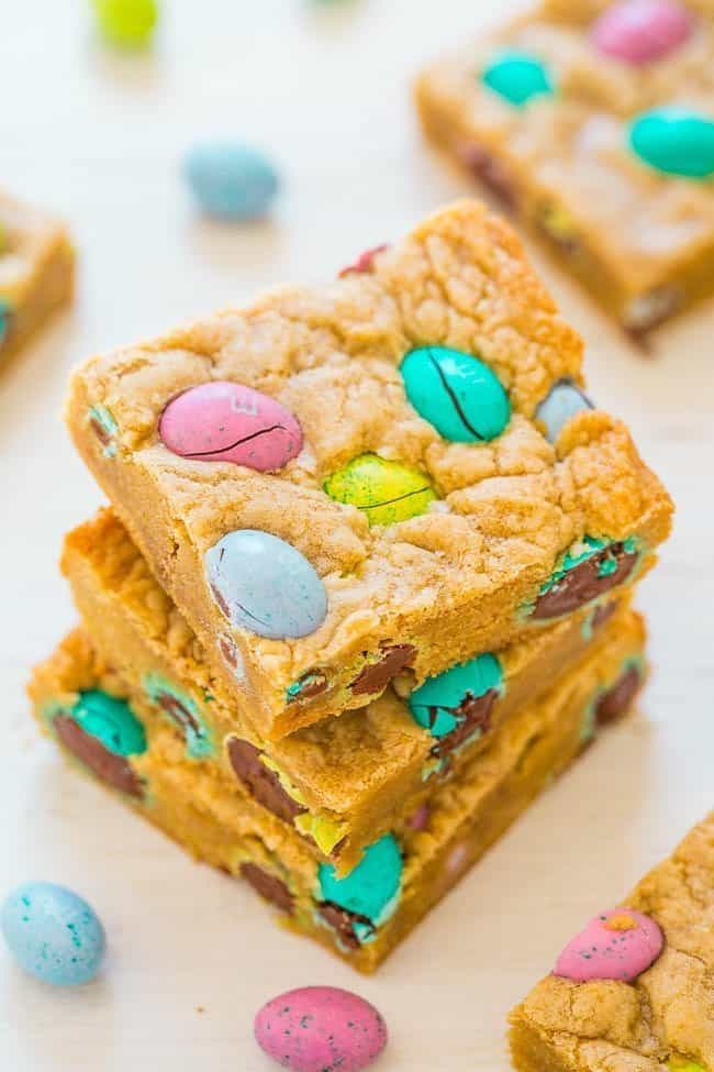 Easter Egg Blondies - Fast, EASY, super soft, and loaded with chocolate M&M Eggs galore!! Definitely my favorite type of Easter eggs! SAVE this recipe for your leftover Easter candy!!