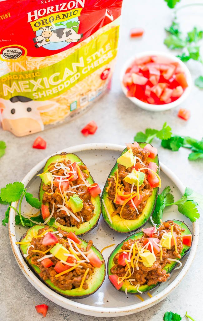 Taco Stuffed Avocados - Like avocados? Then you are going to LOVE these taco STUFFED avocados with ground beef, CHEESE, and more!! EASY, ready in 15 minutes, a family favorite, and perfect for busy weeknights!!