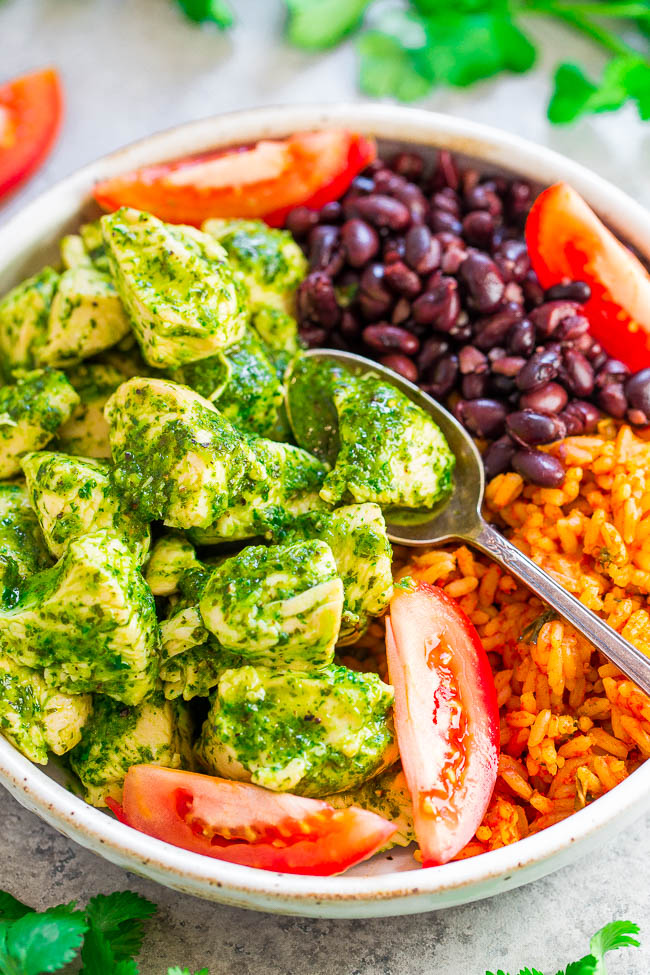 20-Minute Cilantro Chicken with Rice and Beans - EASY, healthy, and the fresh cilantro sauce is SO good!! The chicken is juicy, loaded with flavor, and along with the rice and beans and you'll be SATISFIED for hours!!