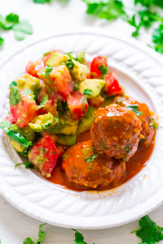Mexican Beef Meatballs with Tomato Avocado Salad - These FAST and EASY beef meatballs are packed with protein that can provide strength to fuel the whole family. They're coated in enchilada sauce and are loaded with Mexican-inspired flavors!! Great for busy weeknight dinners or easy-breezy entertaining!! #BeefItsWhatsForDinner #NicelyDone