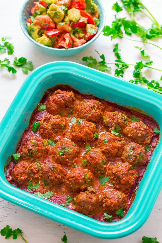 Overhead picture of Mexican Meatballs with Tomato Avocado Salad in a blue dish