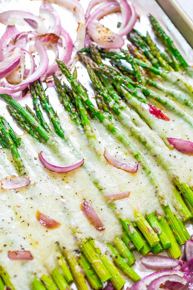 Cheesy Roasted Asparagus - Even picky eaters will LOVE asparagus when it's roasted with onions and covered with melted CHEESE!! A fast and EASY side that's perfect for busy weeknights!!