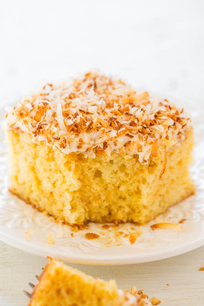 Square of Coconut Caramel Poke Cake on a white plate