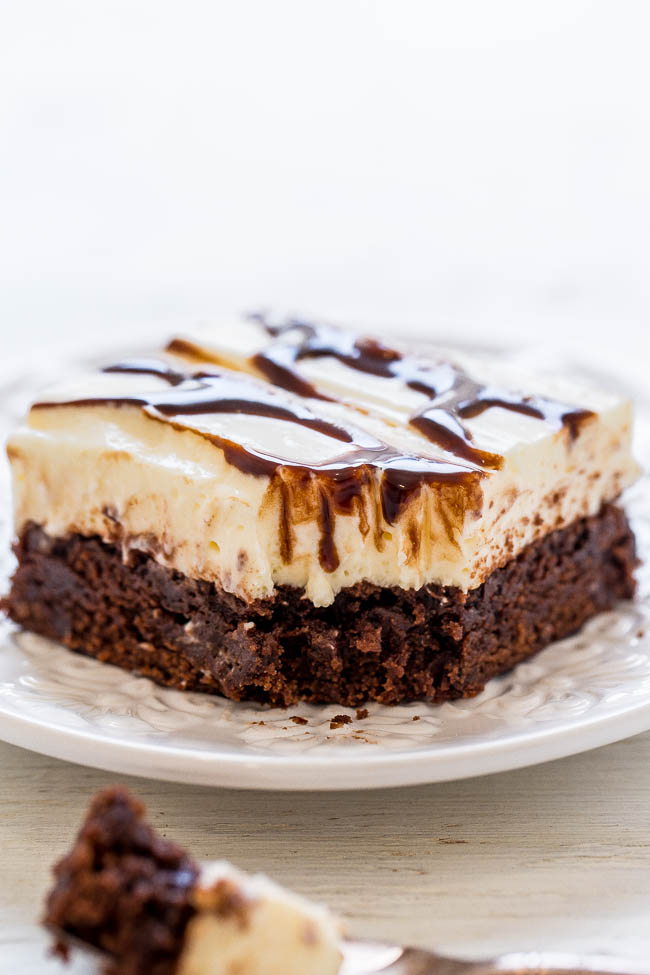 Fudge Ripple Brownies - Forget fudge ripple ice cream and try on of these EASY, decadent, and AMAZING brownies instead!! They're topped with a cream cheese-white chocolate pudding-whipped topping layer and chocolate sauce RIPPLES!!