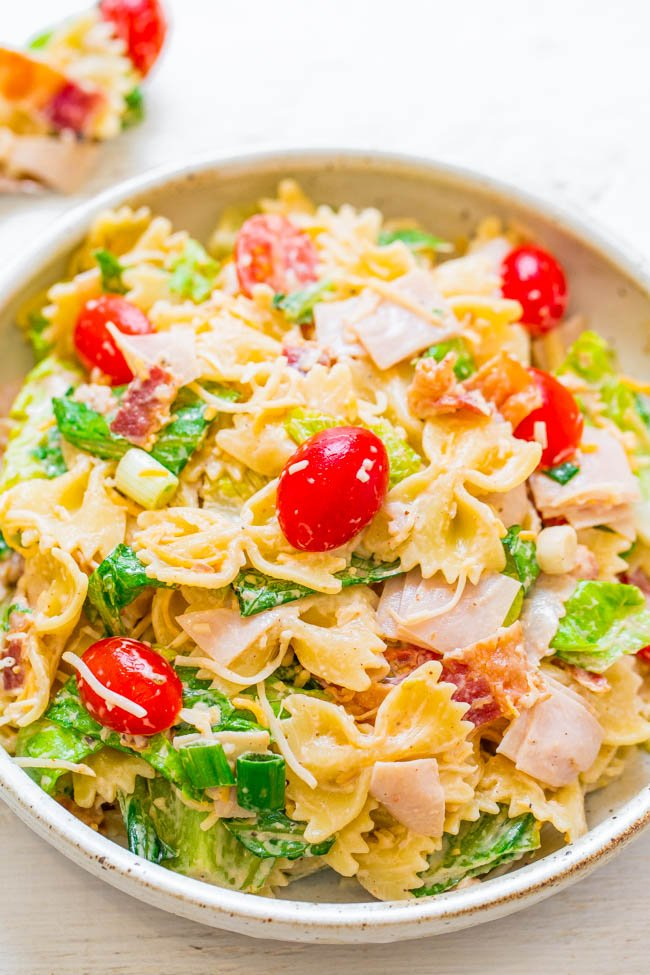 Club Sandwich Pasta Salad - All your favorite club sandwich ingredients in an EASY pasta salad!! Turkey, bacon, tomatoes, lettuce, and cheese with ranch! Ready in 15 minutes and perfect for potlucks, picnics, and parties!!