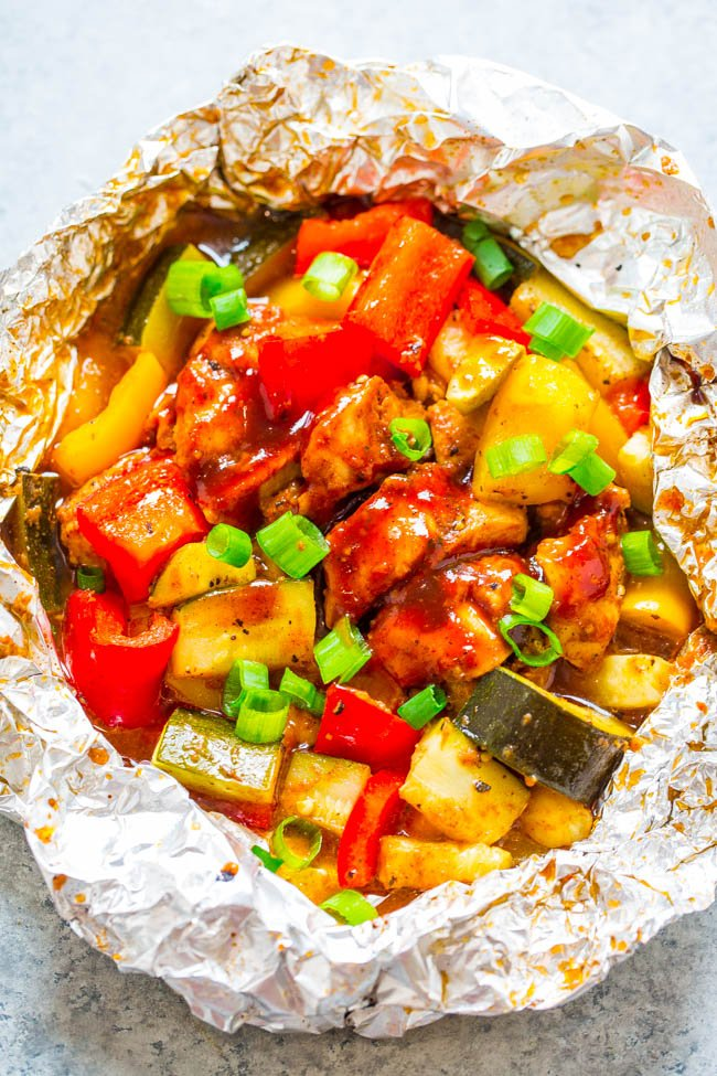 BBQ Chicken Foil Packets — Ready in 15 minutes and such an EASY way to enjoy barbecue chicken on the grill!! A DELISH and HEALTHY meal made in a foil pack with ZERO cleanup!!