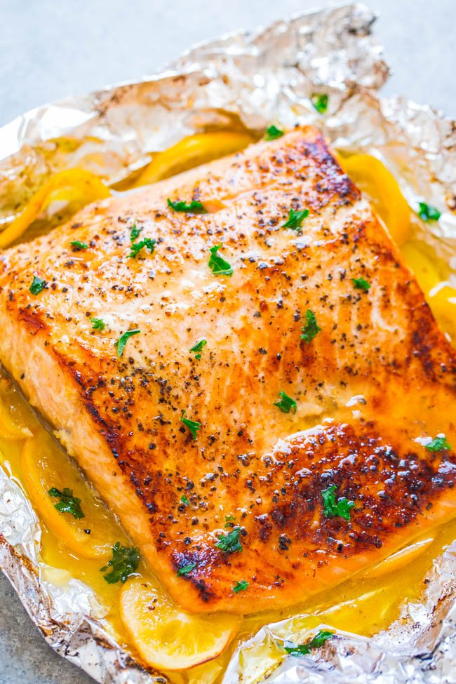 baked salmon filet with garlic butter sauce on piece of foil