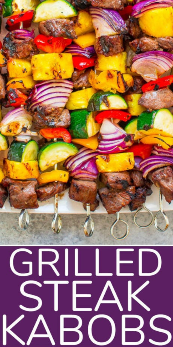 Grilled Steak Kabobs — Juicy steak with sweet bell peppers, onions, zucchini, and pineapple for the PERFECT sweet-and-savory kabob!! You'll want to fire up your grill for these! Fast, EASY, zero cleanup, and DELISH!!