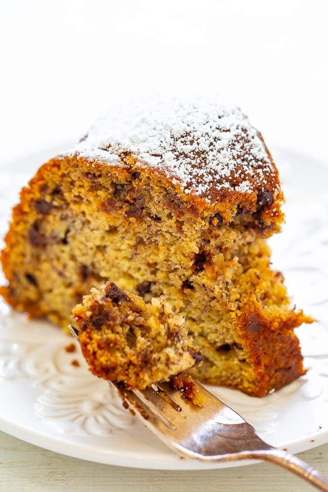 Six-Banana Banana Chocolate Chip Cake - Yes, 6 bananas in 1 cake means it's super SOFT, moist, and has robust banana flavor with chocolate chips in EVERY bite!! EASY and one bowl! Now you know what to do with all your ripe bananas!!