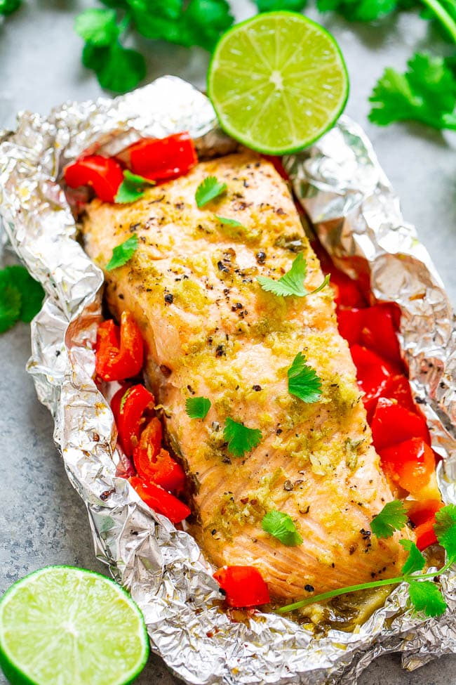 Foil Pack Lime Cilantro Salmon - EASY, ready in 10 minutes, and a FOOLPROOF way to make grilled salmon!! Tender, juicy, and bursting with Mexican-inspired flavors that everyone LOVES!!