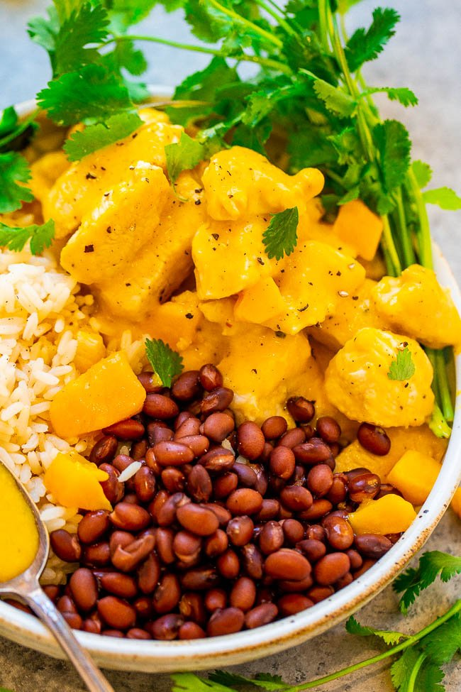 15-Minute Mango Lime Chicken with Rice and Beans - EASY, healthy, and the mango sauce spiked with lime juice is SO tasty!! You can't go wrong with Mexican-inspired flavors, JUICY chicken, and rice and beans!!