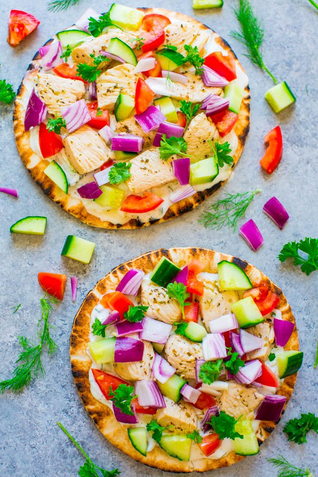 Greek Chicken Pita Pizzas - Chicken gyros transformed into FAST, EASY, and HEALTHY pita pizzas!! There's juicy chicken, homemade tzatziki sauce, tomatoes, cucumbers, onions, and feta on pita bread!! FRESH and LIGHT!!