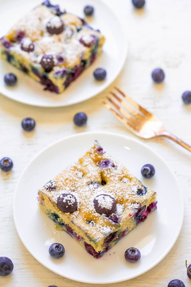 Two Blueberry Pancake Breakfast Squares on white plates