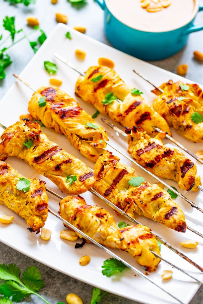 Easy Chicken Satay With Peanut Sauce on white serving platter