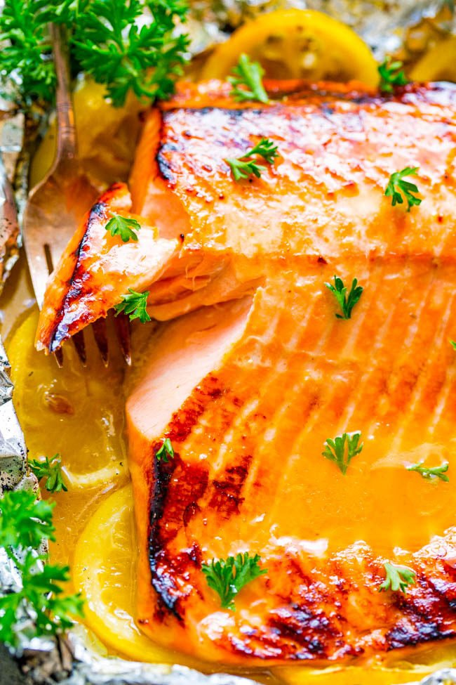Close up of Grilled Honey Lemon Butter Salmon on foil lined pan