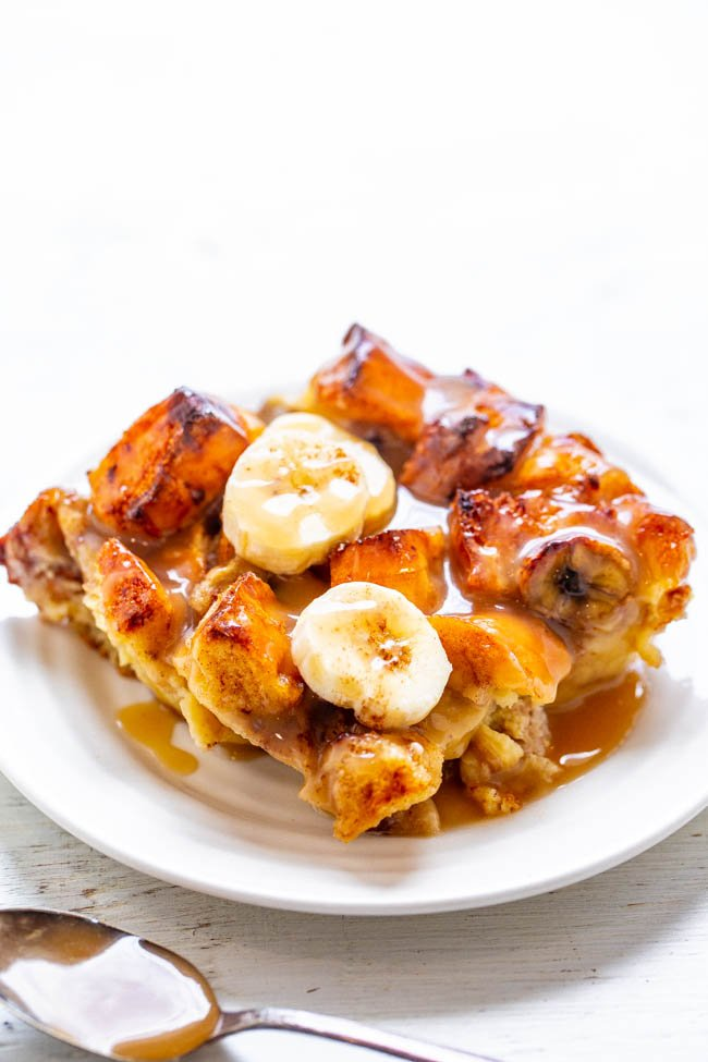 Banana Bread Pudding -Bread pudding meets banana bread in this EASY breakfast or brunch recipe that everyone will LOVE!! Firmer exterior with a custardy interior and an amazing vanilla sauce that is to-die-for!!