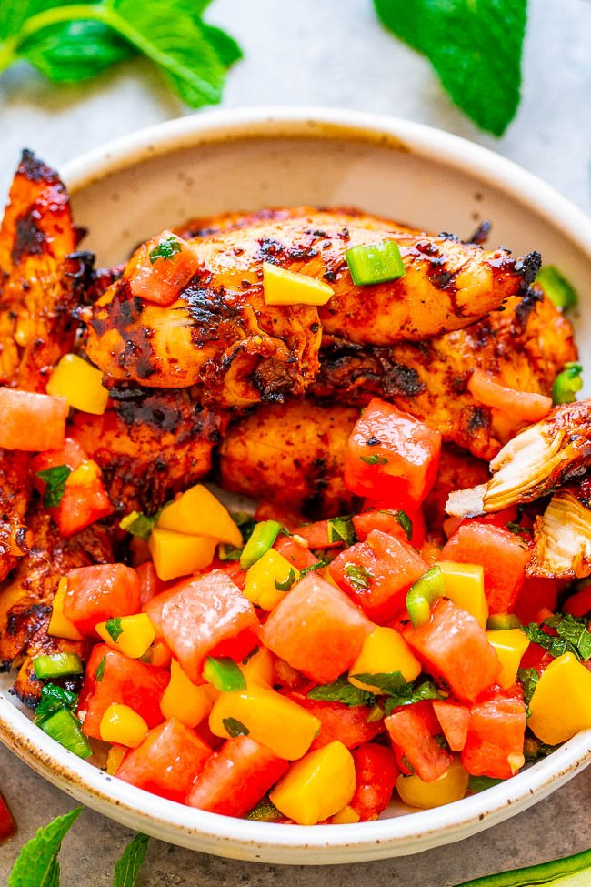 grilled chicken and watermelon mango salsa in white dish