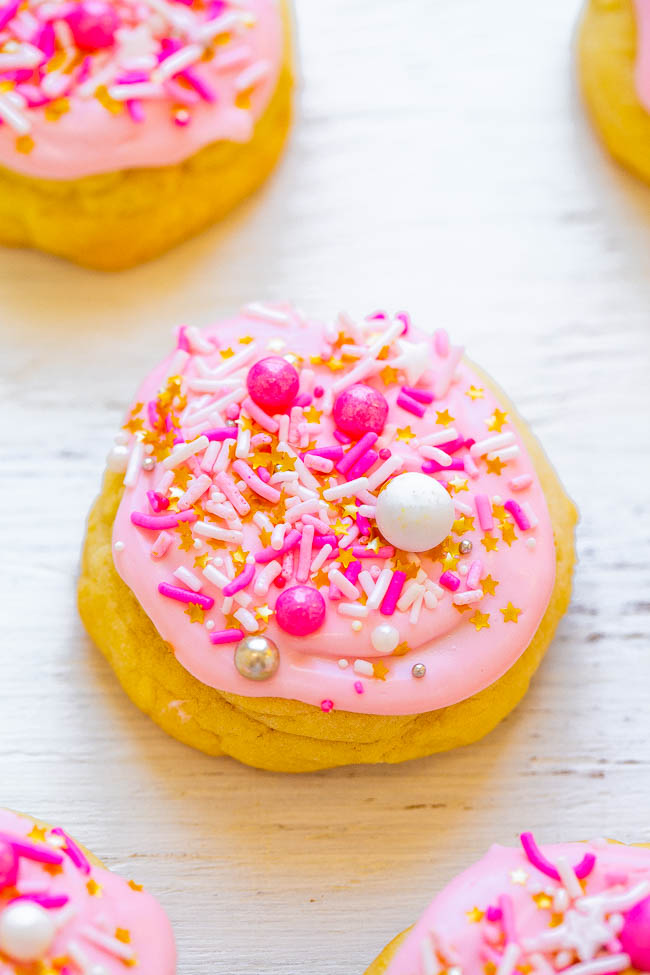 Frosted Soft Sugar Cookies - Super SOFT sugar cookies that just melt in your mouth!! If you've ever thought that sugar cookies can be boring or dry, this EASY recipe with frosting and sprinkles will change your mind! Absolutely DELISH!!