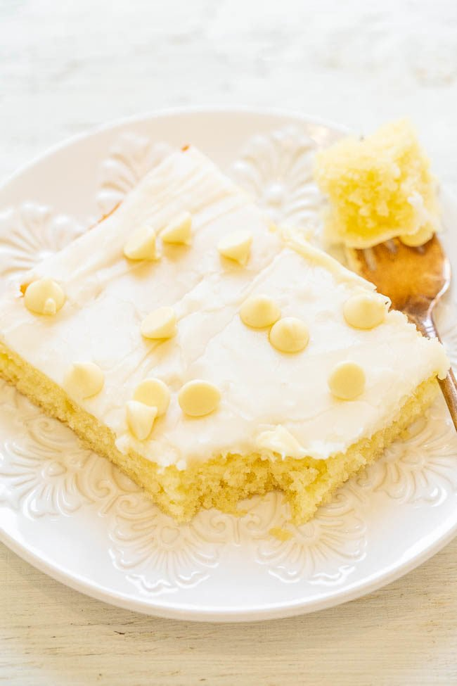 A slice of White Chocolate Texas Sheet Cake on a white plate