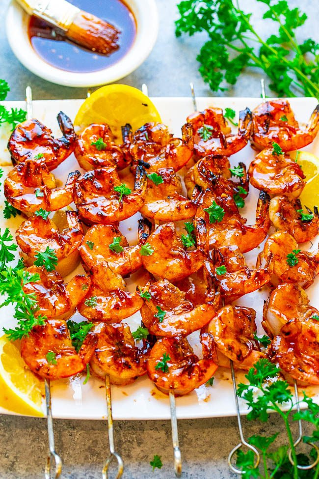Overhead shot of 10-Minute Grilled Honey Barbecue Shrimp  on a white plate