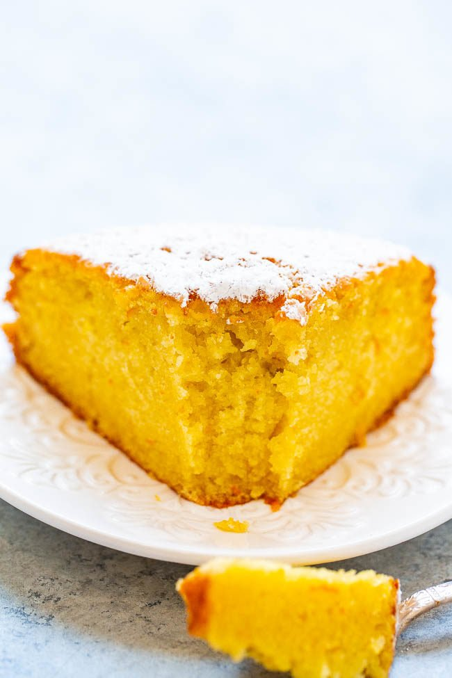 A slice of olive oil orange cake on a white plate