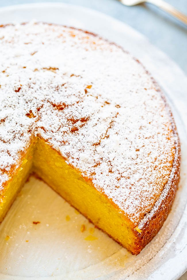 Olive Oil Orange Cake - A super soft and moist cake that's made with olive oil!! Orange zest, orange juice, and Gran Marnier add tons of AMAZING orange flavor to this easy, no-mixer cake that's unique, refined, and INCREDIBLE!!