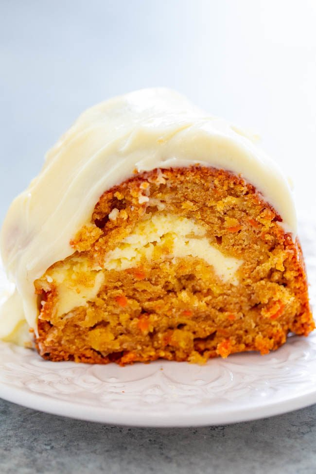 Carrot Apple Cream Cheese Tunnel Cake with Cream Cheese Frosting on a white plate