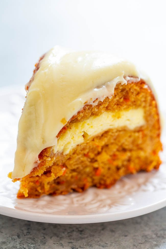 Carrot Apple Cream Cheese Tunnel Cake with Cream Cheese Frosting - If you like carrot cake, you're going to LOVE this version that includes apples and a tunnel of cream cheese that runs through the center!! EASY, amazing, and a MUST-MAKE!!