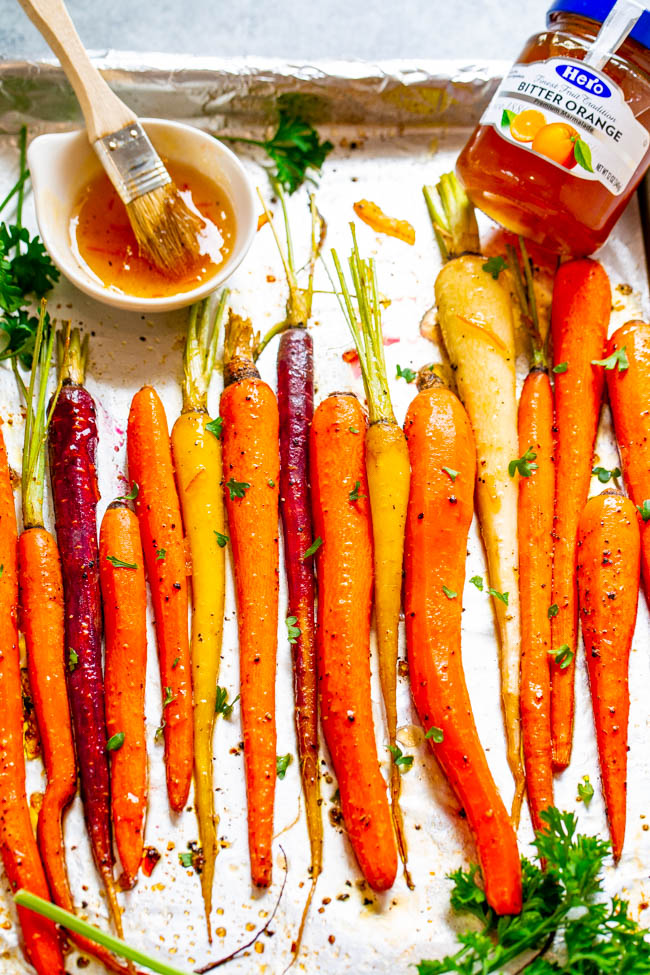 Honey Orange Roasted Carrots - A fast, EASY, and holiday-friendly side dish everyone will love!! The honey orange glaze adds such great FLAVOR and really jazzes up roasted carrots!!