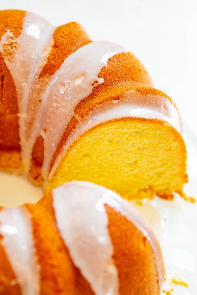 Easy Glazed Pound Cake - Finally a pound cake that isn't dry!! This EASY, buttery, velvety pound cake will be the star of your next party or celebration! If you're looking for that PERFECT pound cake recipe, this is the one!!