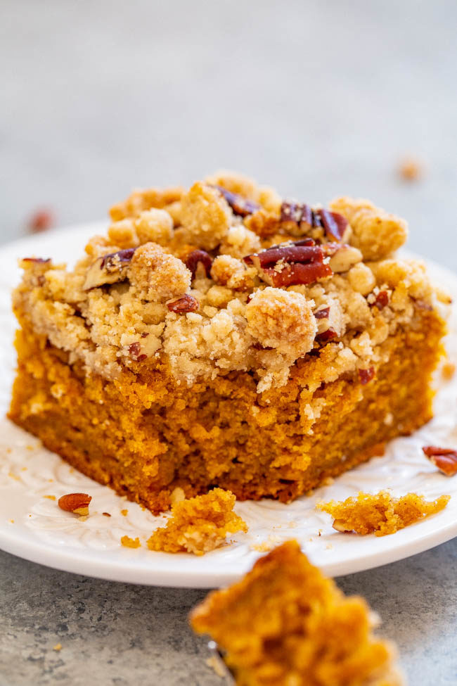 A piece of Pumpkin Crumb Coffee Cake on a white plate