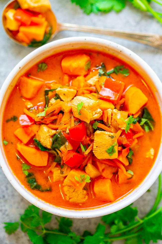 Thai Coconut Curry Chicken Soup - EASY, ready in 30 minutes, HEALTHY, and loaded with FLAVOR!! The sweet potatoes, carrots, red peppers, chicken, spinach, cilantro, and coconut milk broth combine to form an AMAZING soup!!