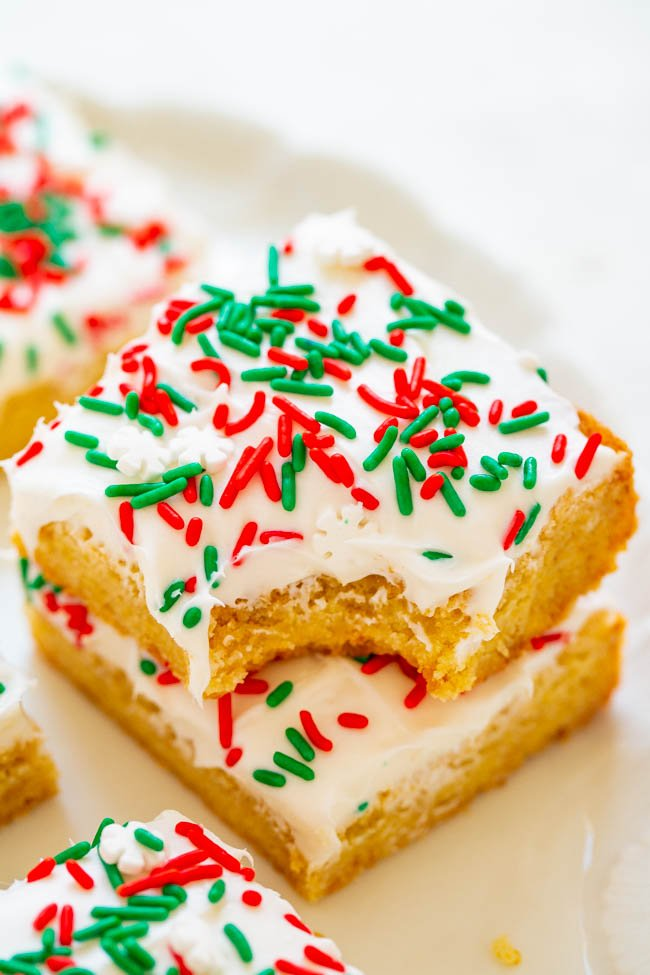 Snickerdoodle Bars with Cream Cheese Frosting -Snickerdoodle bars are so much FASTER AND EASIER than making snickerdoodle cookies!! The sprinkles and tangy cream cheese frosting will put everyone in the holiday spirit!!