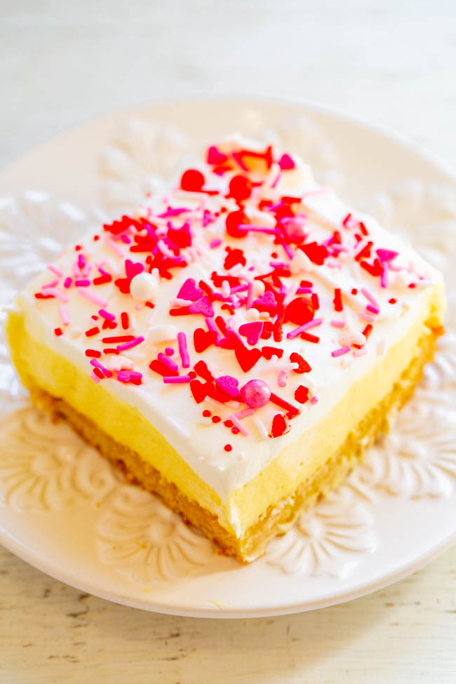 Valentine's Day Vanilla Pudding Sugar Cookie Bars - A sugar cookie crust topped with creamy vanilla pudding, whipped topping, and sprinkles!! A luscious and EASY Valentine's Day dessert that will put everyone in festive spirits!!
