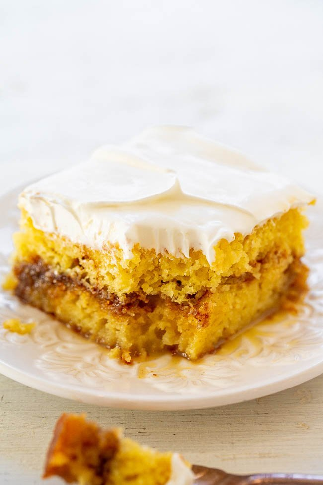 Honey Bun Poke Cake - Tastes like a Honey Bun in cake form!! Sweet, rich, decadent, and reminds me of the Honey Buns I used to eat as a kid! Fast and EASY!!