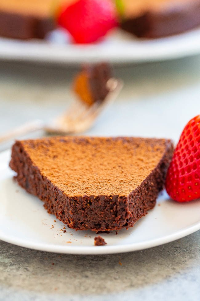 Flourless Chocolate Cake on a white plate with a strawberry