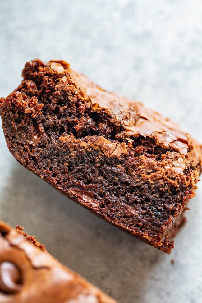 a homemade brownie with chocolate chips, turned on its side